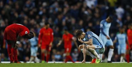 שחקני ליברפול ומנצ'סטר סיטי מאוכזבים בסיום (רויטרס)