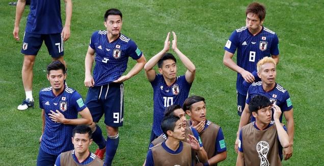 שחקני נבחרת יפן חוגגים (רויטרס)