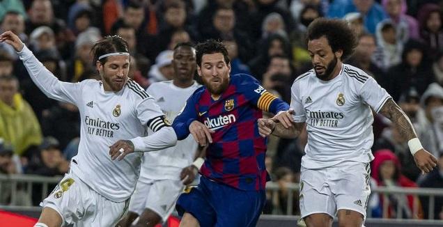 מרסלו וסרחיו ראמוס מקיפים את ליאו מסי (La Liga)