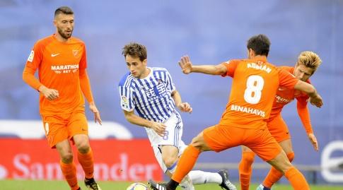 עדנאן יאנוזאי בין שני שחקנים (La Liga)