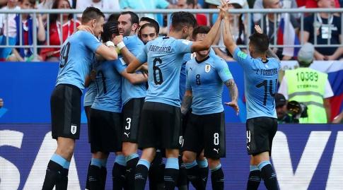 שחקני אורוגוואי חוגגים. ידברו חזק בקופה (רויטרס)