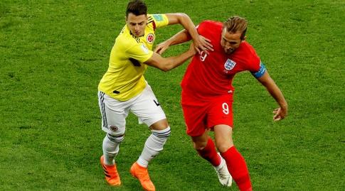 הארי קיין וסנטיאגו אריאס נאבקים על הכדור (רויטרס)