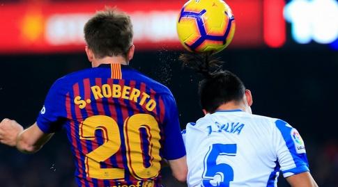 ג'ונתן סילבה וסרג'י רוברטו מנסים לנגוח בכדור (La Liga)