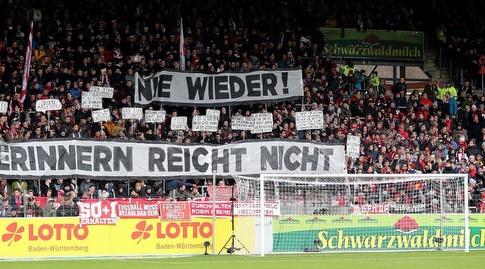 אוהדים בגרמניה מנציחים את יום השואה הבינלאומי (רויטרס)
