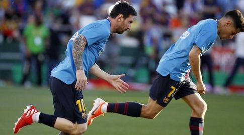 פיליפה קוטיניו וליאו מסי בחימום (La Liga)