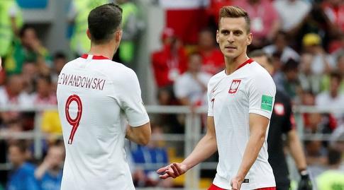 ארקדיוש מיליק ורוברט לבנדובסקי במדי נבחרת פולין. התקשו לשחק יחדיו (רויטרס)