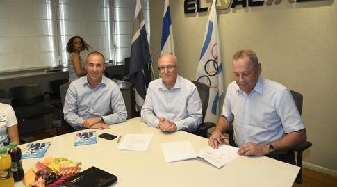 יגאל כרמי, גונן אוסישקין ואלי דפס (הוועד האולימפי בישראל)