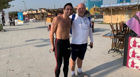 יובל ספרא ומאמנו אנדריי טוט (באדיבות הוועד האולימפי בישראל)