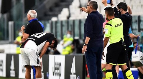 מאוריציו סארי ופאולו דיבאלה אחרי הפציעה (רויטרס)