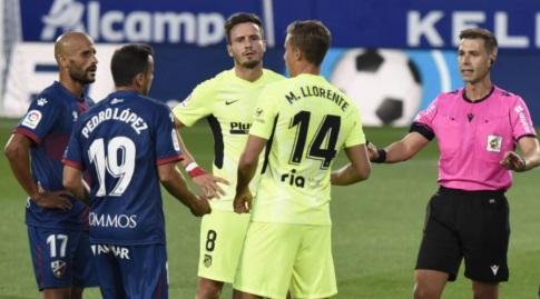 מרקוס יורנטה וסאול במהלך המשחק (La Liga)